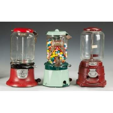 Three Vintage Gumball Machines