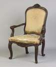 Carved Walnut Continental Armchair