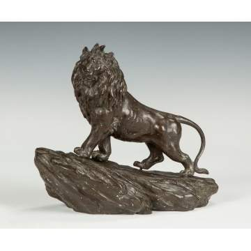 Bronze Sculpture of a Lion on a Mountain