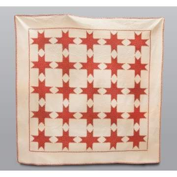 Quilt with Red Feather Stars