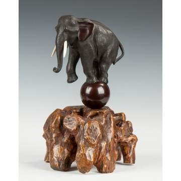 Bronze Elephant on Natural Root Base