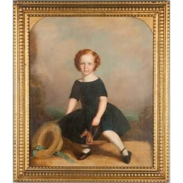 Portrait of Young Girl with Hat and Horse Ride Toy