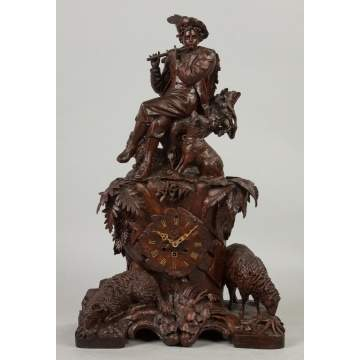 Carved Black Forest Clock with Figure Playing Flute, Dogs and Bighorn Sheep