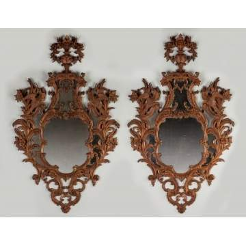 A Pair of Carved Continental Mirrors
