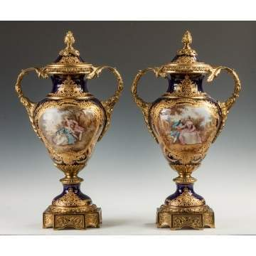 Fine Pair of Sevres Style Porcelain Cobalt Blue Covered Urns with Courting Couples and Landscapes