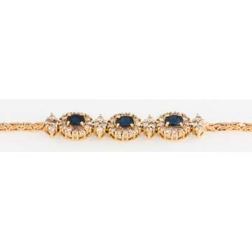 Gold and Diamond Bracelet with Garnets