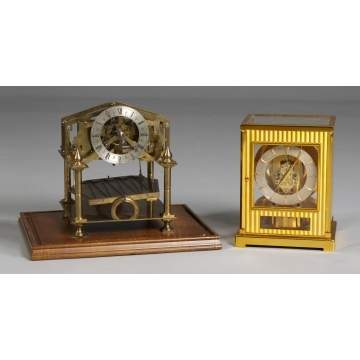 L - Atmos Le Coultre, R - Congreve Rolling Ball Clock.