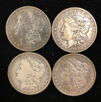 Four Liberty Head Silver Dollars
