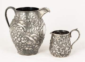 Two Sterling Repoussé Pitchers