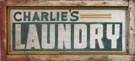 """Charlie's Laundry"" Painted Wood & Tin Sign"