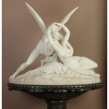A Large Carved Marble Group of Cupid and Psyche on Green Marble Pedestal