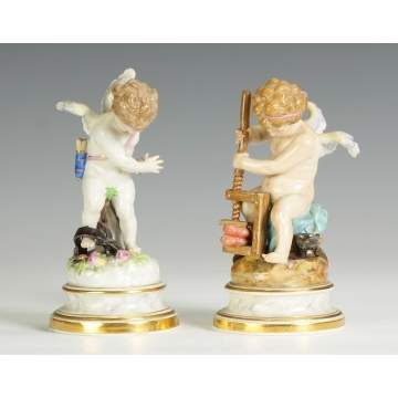 Two Meissen Cupid Figurines
