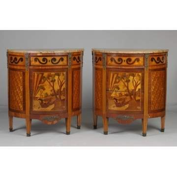 A Pair of French Inlaid Bow Front Marble Top Commodes