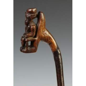 Carved Cane w/Seated Gentleman, Coat & Hat
